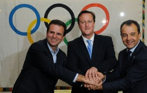 Prime Minister David Cameron (center) shakes hands with the Mayor of Rio de Janeiro Eduardo Paes (left) and the Governor of Rio Sergio Cabral (right) at Palacio da Cidade
