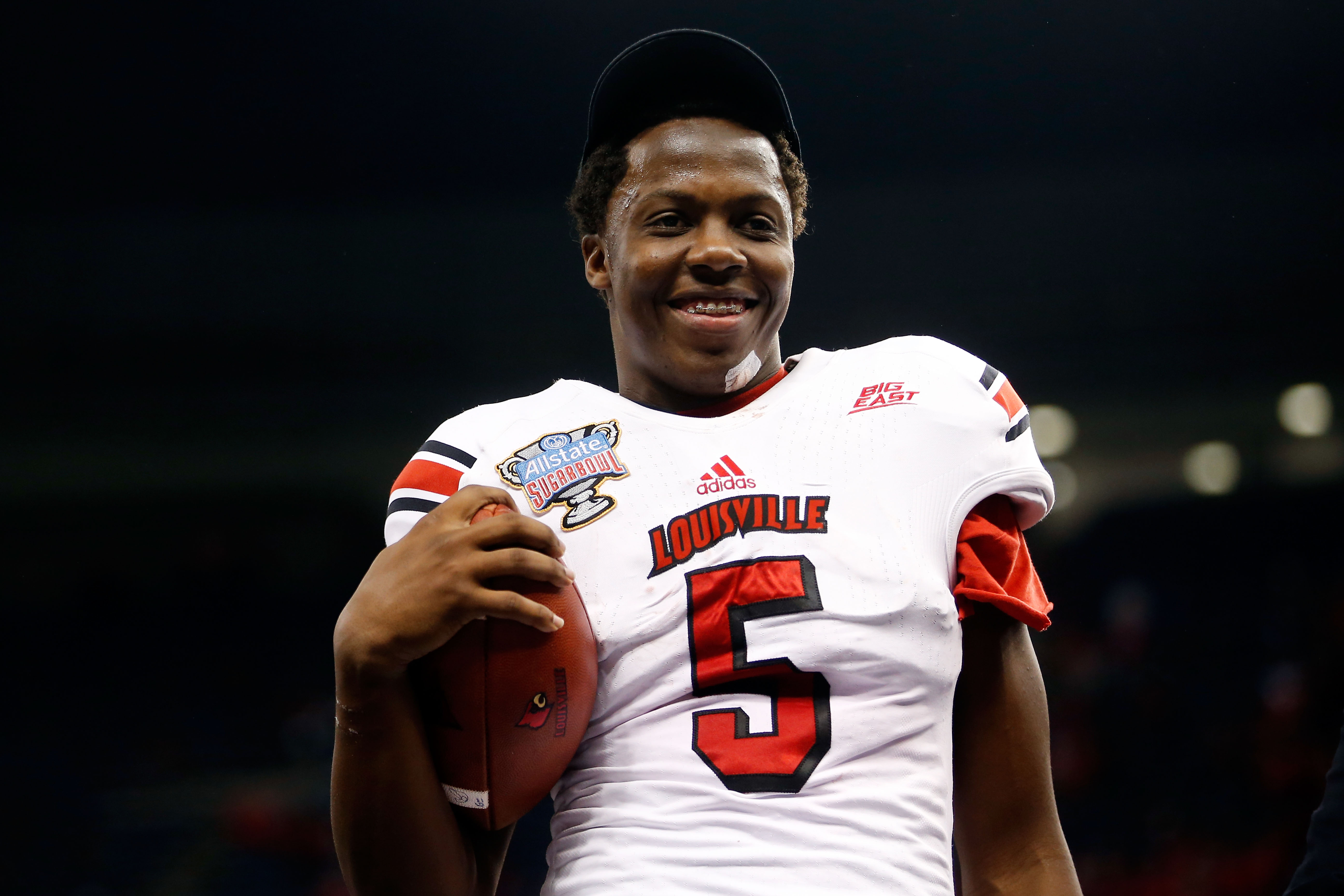 Louisville Quaterback Teddy Bridgewater Shares Special Bond with Offensive Coordinator