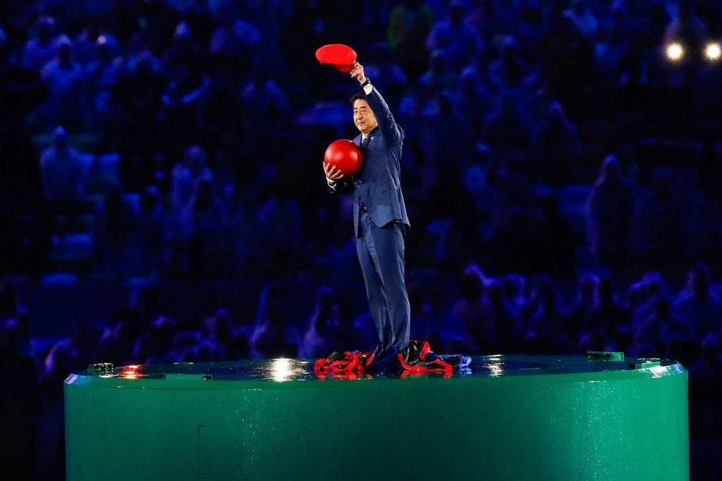 Japanese Prime Minister Shinzō Abe introduces Tokyo 2020 at the Rio 2016 Olympic Games closing ceremony. Photo By Fernando Frazão/Agência Brasil - http://agenciabrasil.ebc.com.br/rio-2016/foto/2016-08/cerimonia-de-encerramento-dos-jogos-olimpicos-rio-2016-0, CC BY 3.0 br, https://commons.wikimedia.org/w/index.php?curid=50820080