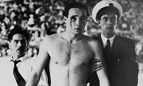 Hungary's Ervin Zador is escorted from the pool with blood pouring from his cut eye during their 1956 Olympic water polo win over Russia. Photo: Bettmann/Corbis