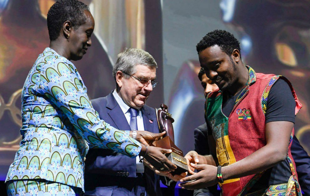 Dagim Zinabu Tekle, right, accepts the IOC Women and Sport World Trophy. Photo: International Olympic Committee