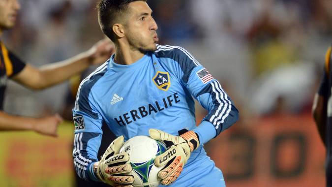 Aug 17, 2013; Carson, CA, USA;  Los Angeles Galaxy goalkeeper Jaime Penedo (18) makes a save during the game against Real Salt Lake at the StubHub Center. Galaxy won 4-2.  Mandatory Credit: Jayne Kamin-Oncea-USA TODAY Sports