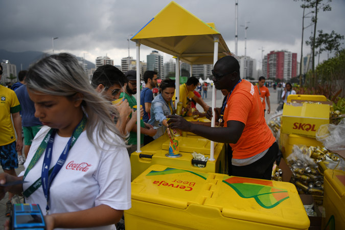 A stand selling beer in the Olympic Park. Some lines to enter venues and buy food have had up to 90-minute wait times. Photo: James Hill for The New York Times