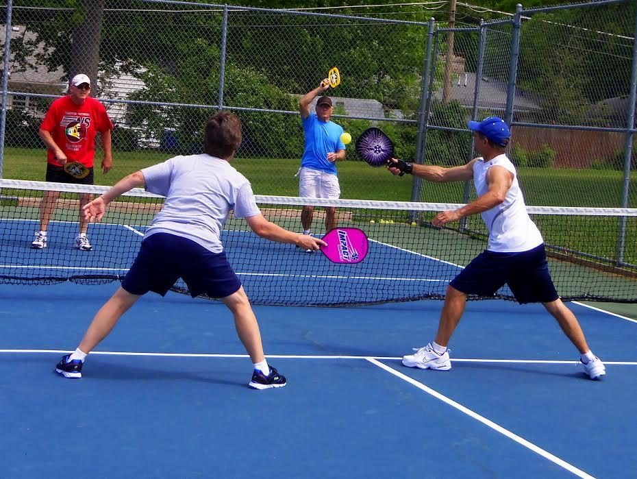 the sport of pickleball A fun sport that combines elements of tennis, badminton, and ping pong, pickleball can be played indoors or outdoors on a badminton-sized court with a slightly modified tennis net it is played with a paddle and a plastic ball.